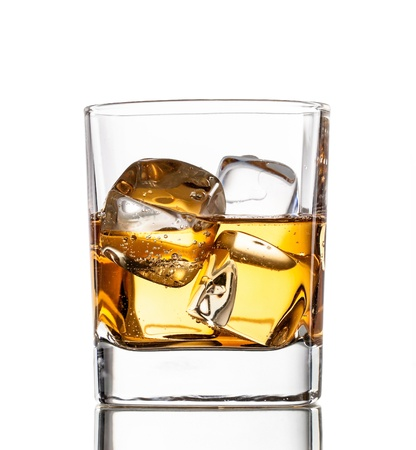 Glass of whiskey, isolated on white background photo