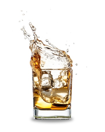 Whiskey splashing out of glass, isolated on white background photo