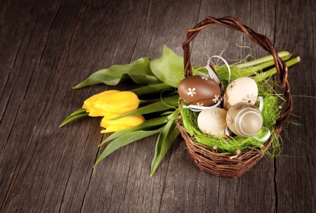 flower baskets: Easter still life with eggs in basket Stock Photo