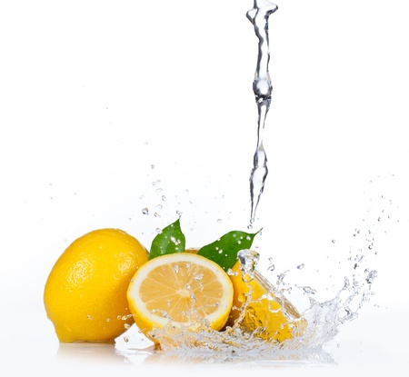 lemon water: Fresh lemons with water splash, isolated on white background Stock Photo