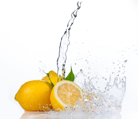 Fresh lemons with water splash, isolated on white background photo