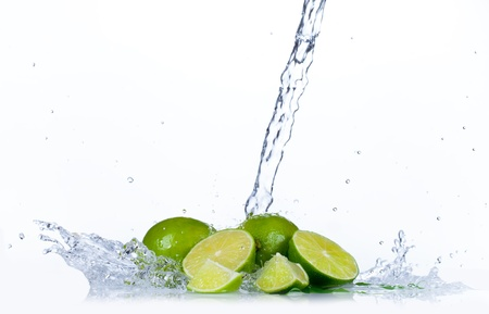 Fresh limes with water splash, isolated on white background photo