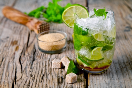 lime green background: Fresh mojito drink