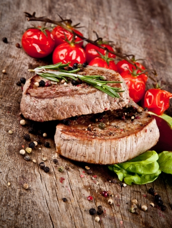 medium close up: Delicious beef steaks on wood