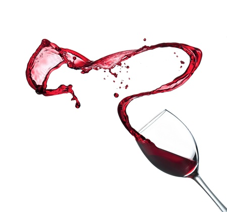Red wine splashing from glass, isolated on white background photo