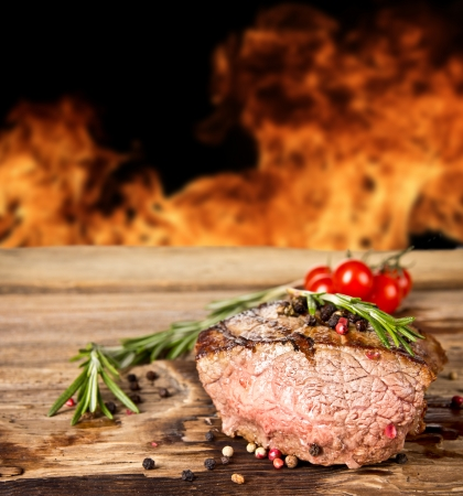 Grilled beef steak with flames on background Stock Photo - 18302918