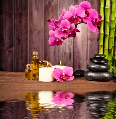 wooden aromatherapy: Spa still life with water reflection
