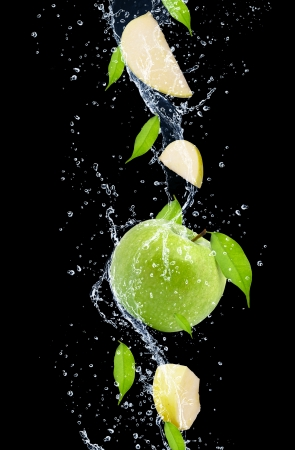 soda water: Green apples in water splash, isolated on black background