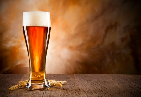 Glass of beer on wooden table Stock Photo