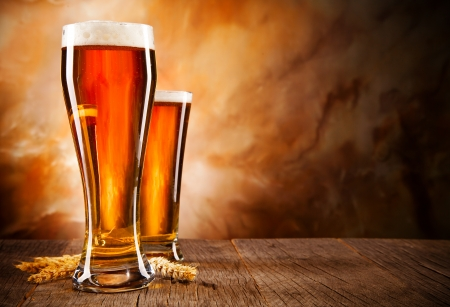 beer pint: Glasses of beer on wooden table