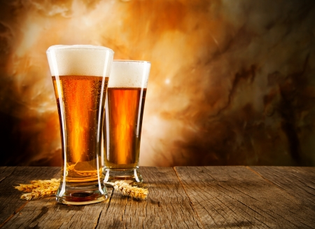 2 objects: Glasses of beer on wooden table
