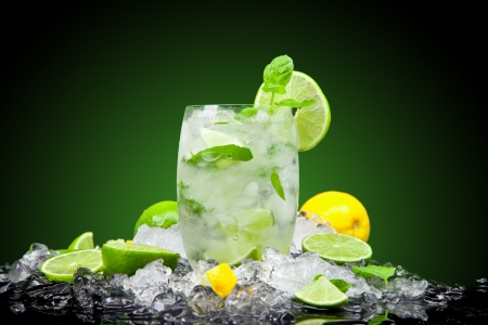 caipirinha: Fruit cocktail with dark background Stock Photo