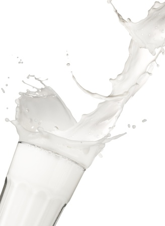 milk drop: Pouring milk into glass, isolated on white background