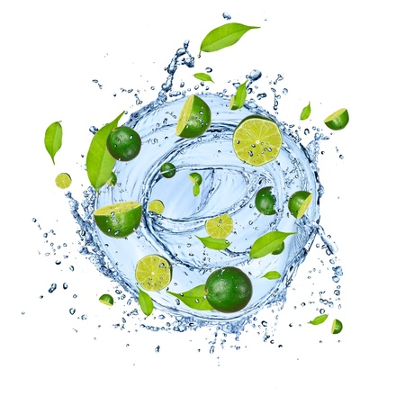 limelight: Limes pieces falling in water splash, isolated on white background  Stock Photo