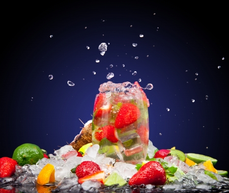 Fruit cocktail with dark background photo
