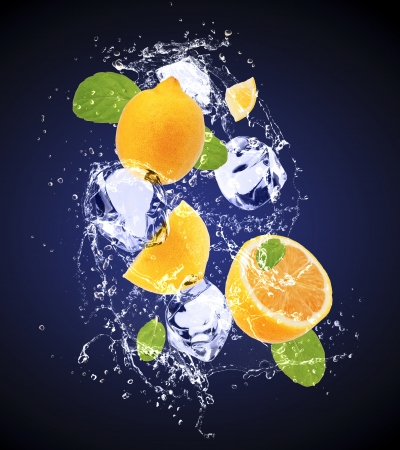 Isolated shot of fresh lemons with ice and water Stock Photo - 19555327