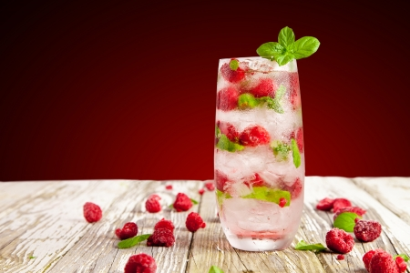 Fresh summer cocktail with raspberries photo