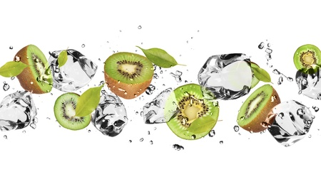 Pieces of kiwi with ice cubes, isolated on white background photo