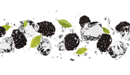 Pieces of blackberries with ice cubes, isolated on white background photo