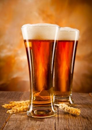 woden: Glasses of beer on woden table