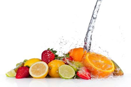 Fresh fruit with water splash, isolated on white background photo