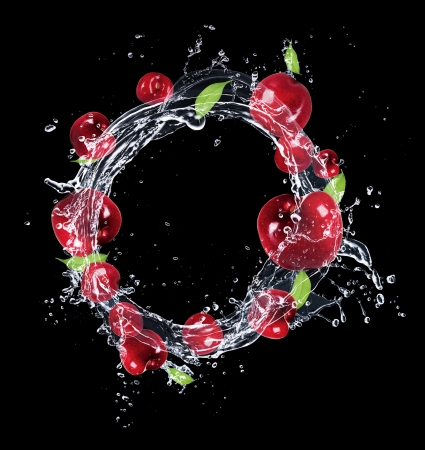 Fresh cherries in water splash on black background photo