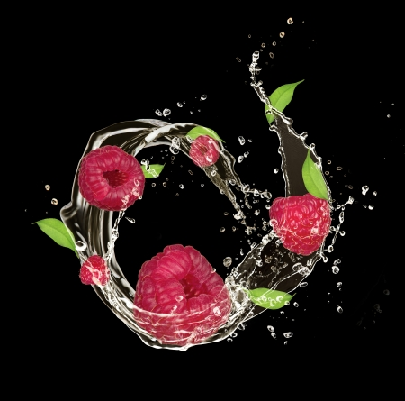 Fresh raspberries in water splash, isolated on black background photo