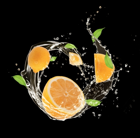 Fresh lemons in water splash, isolated on black background photo