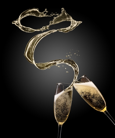 Glasses of champagne with splash, isolated on black Stock fotó
