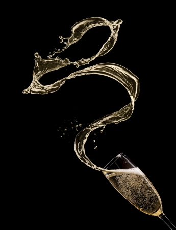 Glass of champagne with splash, isolated on black photo