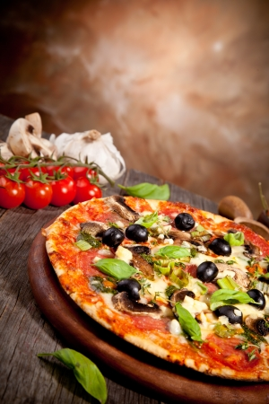 Delicious fresh pizza served on wooden table Stock Photo