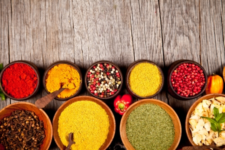 Various spices in wooden bowls photo