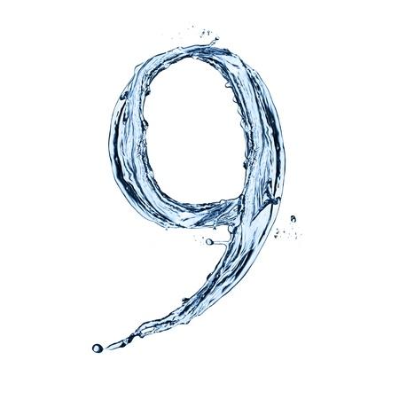 """numero nueve: El agua salpica número """"9"""" aislado en el fondo negro Foto de archivo"""