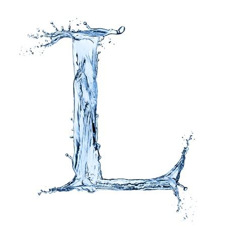 """pila bautismal: El agua salpica letra """"L"""" sobre fondo negro Foto de archivo"""