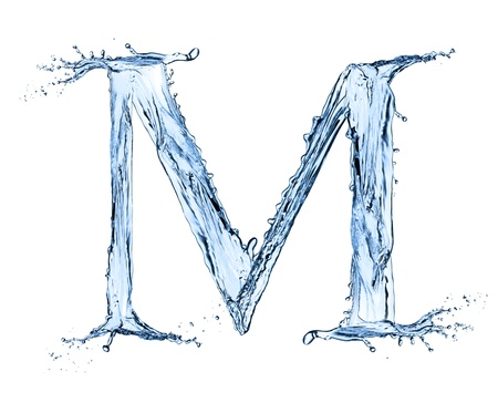 Water splashes letter M isolated on black background photo