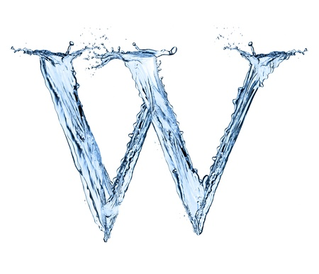 Water splashes letter W isolated on black background photo