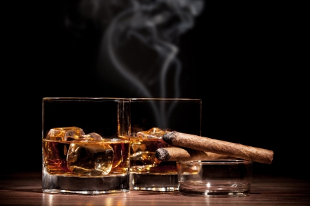ashtray: Whiskey drinks with smoking cigars on wooden table