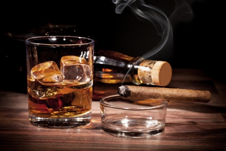 cigars: Whiskey drink with smoking cigar on wooden table Stock Photo