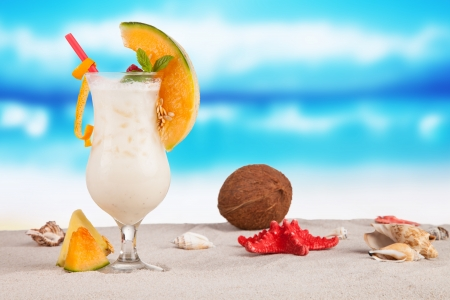 colada: Summer drink on beach with sea shells Stock Photo