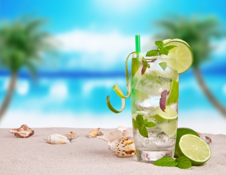 Mojito drink on beach with sea shells photo