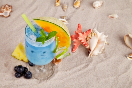 Summer drink on beach with sea shells photo