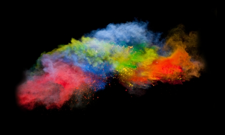 blue paint: Freeze motion of colored dust explosion isolated on black background Stock Photo