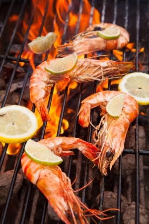 Fresh grilled prawns on fire Фото со стока