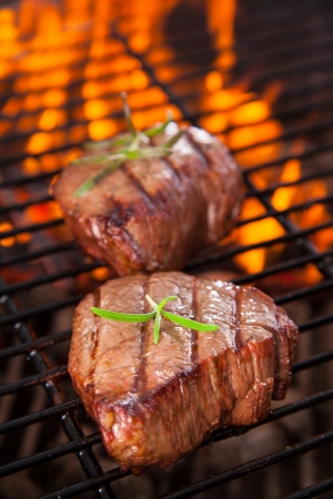 barbecue: Delicious beef steaks on grill