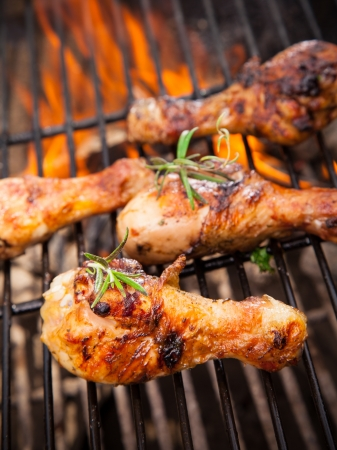 barbecue: Grilled chicken legs on fire