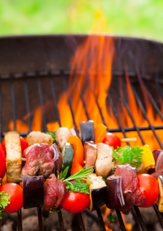 barbequing: Delicious fresh skewers on grill Stock Photo