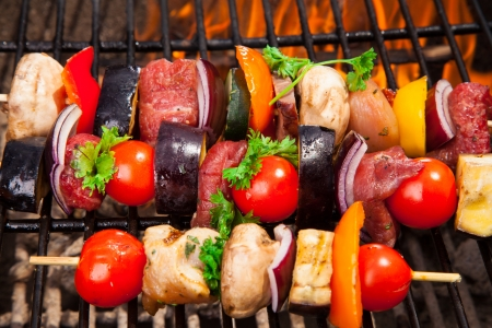 bbq chicken: Delicious fresh skewers on grill Stock Photo