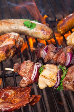 barbequing: Delicious fresh meat on grill Stock Photo