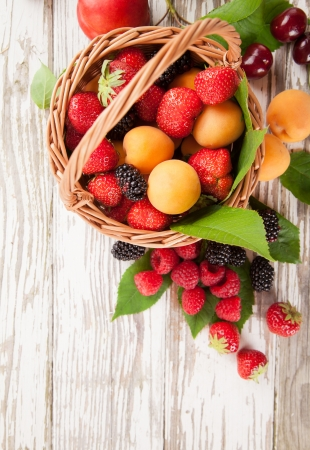 strawberry baskets: Fresh harvested fruit in basket Stock Photo
