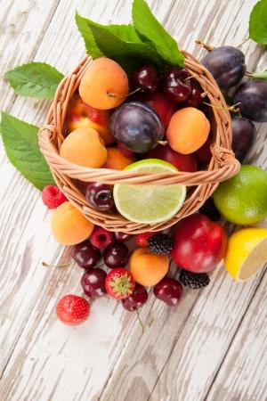 Fresh harvested fruit in basket Stock Photo